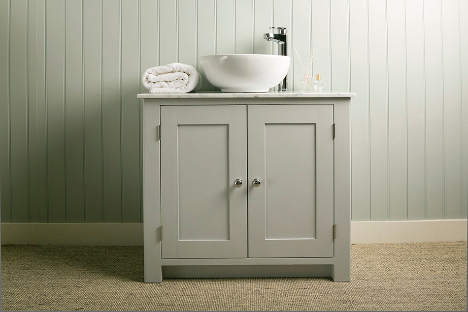 bathroom vanity cabinet with carrara marble top and countertop sink